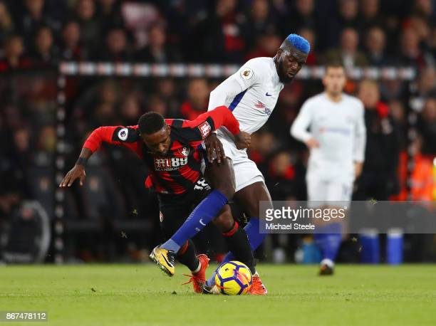 Jermain Defoe of AFC Bournemouth is tackled by Tiemoue Bakayoko of Chelsea during the Premier League match between AFC Bournemouth and Chelsea at...
