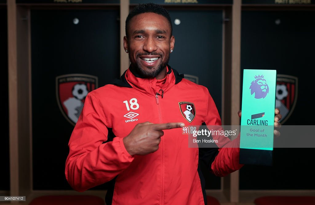 Jermain Defoe of Bournemouth poses with the trophy for Carling Premier League Goal of the Month for December 2017 on January 11, 2018 in Bournemouth, England.