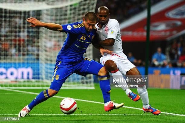 Jermain Defoe of England battles with Yaroslav Rakytskiy of Ukraine during the FIFA 2014 World Cup Group H qualifying match between England and...