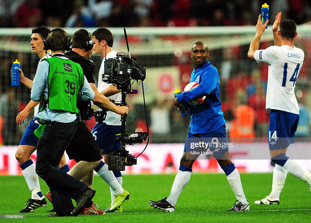 Jermain Defoe of England celebrates as he walks off with the match ball after scoring a hat trick during the UEFA EURO 2012 Group G Qualifying match between England and Bulgaria at Wembley Stadium on September 3, 2010 in London, England.