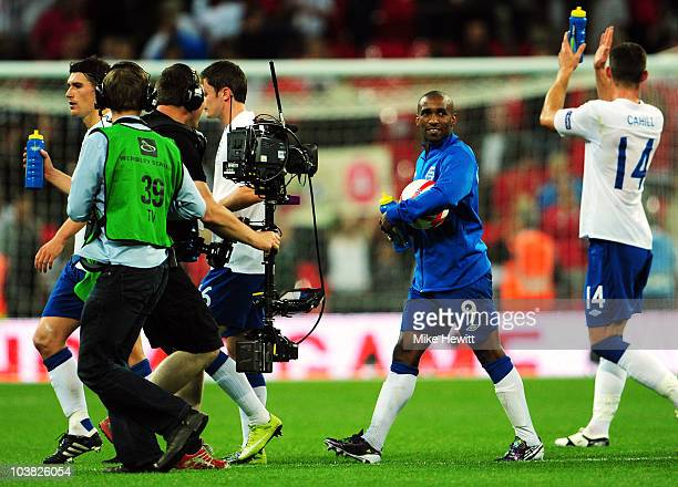 Jermain Defoe of England celebrates as he walks off with the match ball after scoring a hat trick during the UEFA EURO 2012 Group G Qualifying match...