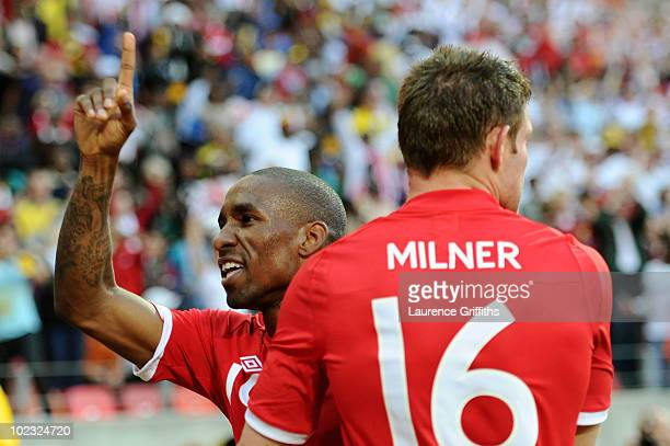 Jermain Defoe of England celebrates scoring the opening goal with team mate James Milner during the 2010 FIFA World Cup South Africa Group C match...