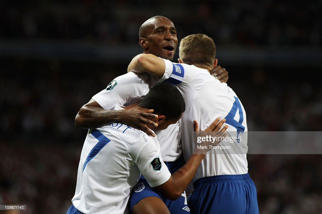 Jermain Defoe (C) of England celebrates with team mates Theo Walcott (L) and Steven Gerrard (R) after scoring during the UEFA EURO 2012 Group G Qualifying match between England and Bulgaria at Wembley Stadium on September 3, 2010 in London, England.