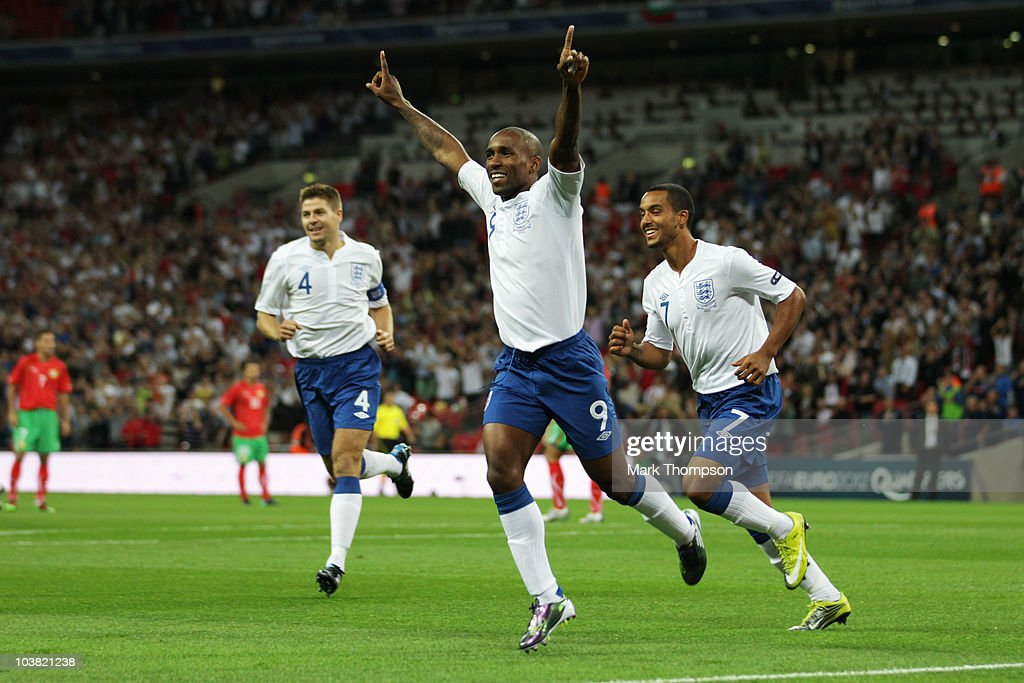 Jermain Defoe (C) of England celebrates with team mates Theo Walcott (R) and Steven Gerrard (L) after scoring during the UEFA EURO 2012 Group G Qualifying match between England and Bulgaria at Wembley Stadium on September 3, 2010 in London, England.