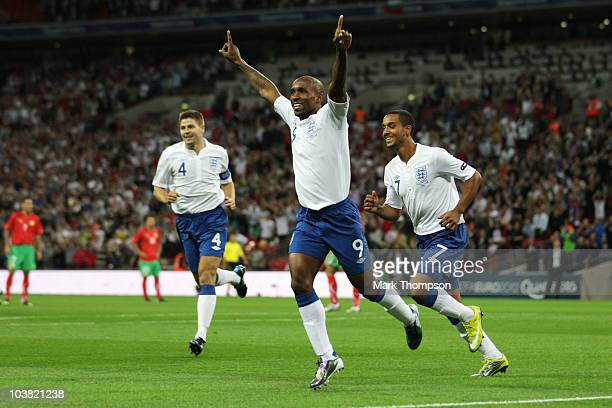 Jermain Defoe of England celebrates with team mates Theo Walcott and Steven Gerrard after scoring during the UEFA EURO 2012 Group G Qualifying match...