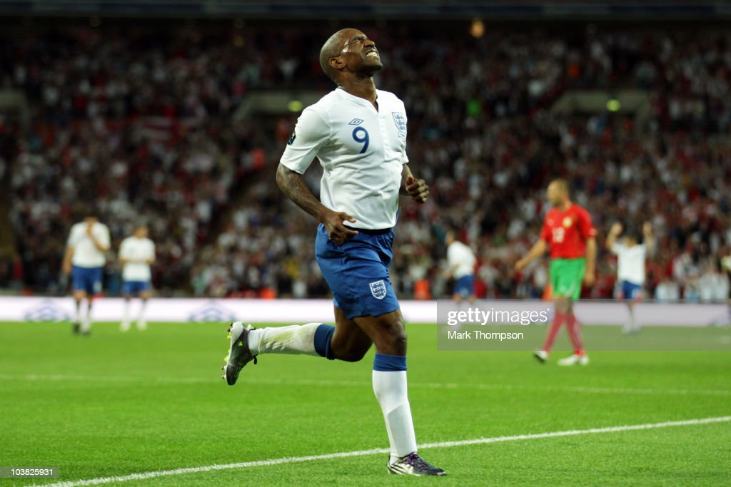 Jermain Defoe of England grimaces as he celebrates scoring his third goal during the UEFA EURO 2012 Group G Qualifying match between England and Bulgaria at Wembley Stadium on September 3, 2010 in London, England.