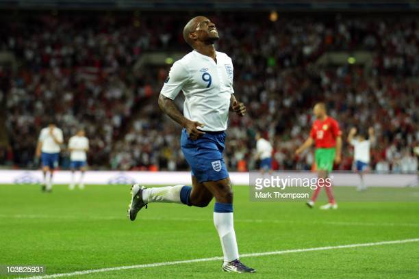 Jermain Defoe of England grimaces as he celebrates scoring his third goal during the UEFA EURO 2012 Group G Qualifying match between England and...