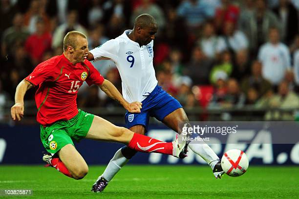 Jermain Defoe of England is tackled by Ivan Ivanov of Bulgaria as he shoots to score his third goal during the UEFA EURO 2012 Group G Qualifying...