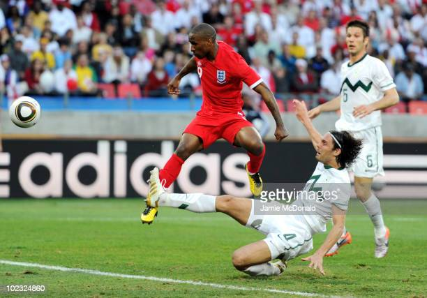 Jermain Defoe of England scores the opening goal during the 2010 FIFA World Cup South Africa Group C match between Slovenia and England at the Nelson...