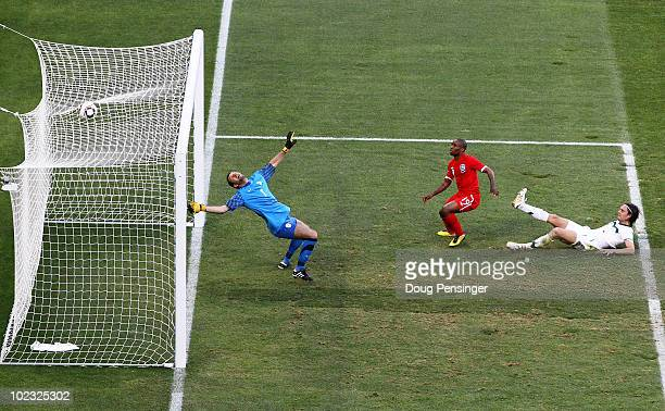 Jermain Defoe of England scores the opening goal past Samir Handanovic of Slovenia during the 2010 FIFA World Cup South Africa Group C match between...