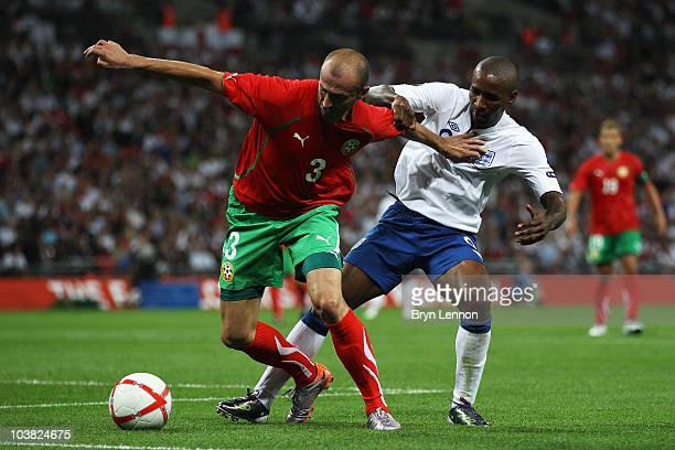 Jermain Defoe of England tackles IIiyan Stoyanov of Bulgaria during the UEFA EURO 2012 Group G Qualifying match between England and Bulgaria at...