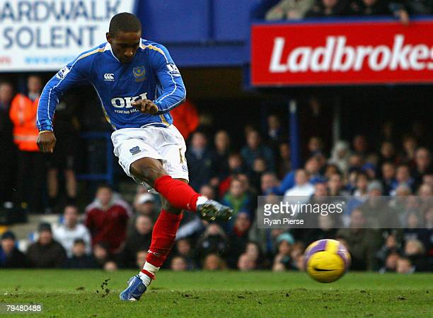 Jermain Defoe of Portsmouth scores his teams first goal during the Barclays Premier League match between Portsmouth and Chelsea at Fratton Park on...