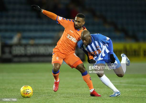 Jermain Defoe of Rangers battles for possession with Youssouf Mulumbu of Kilmarnock FC during the Scottish Cup 5th Round match between Kilmarnock and...