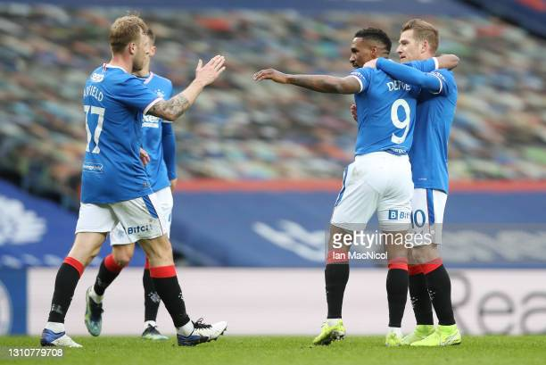 Jermain Defoe of Rangers celebrates with teammates after scoring their team's first goal during the William Hill Scottish Cup Third Round match...