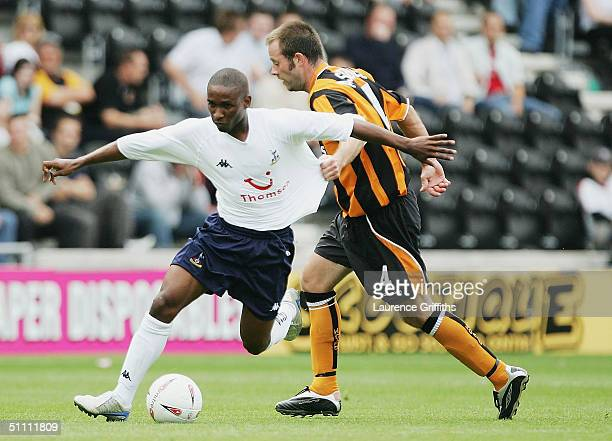 Jermain Defoe of Spurs breaks past Ian Ashbee of Hull during the Pre Season Friendly match between Hull City and Tottenham Hotspur at The KC Stadium...