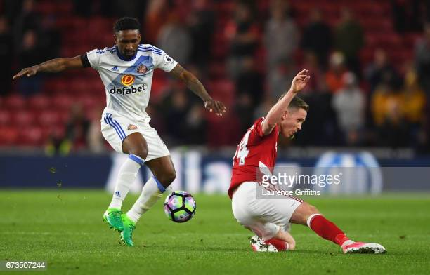 Jermain Defoe of Sunderland and Adam Forshaw of Middlesbrough in action during the Premier League match between Middlesbrough and Sunderland at the...