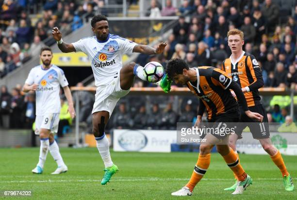 Jermain Defoe of Sunderland and Andrea Ranocchia of Hull City compete for the ball during the Premier League match between Hull City and Sunderland...