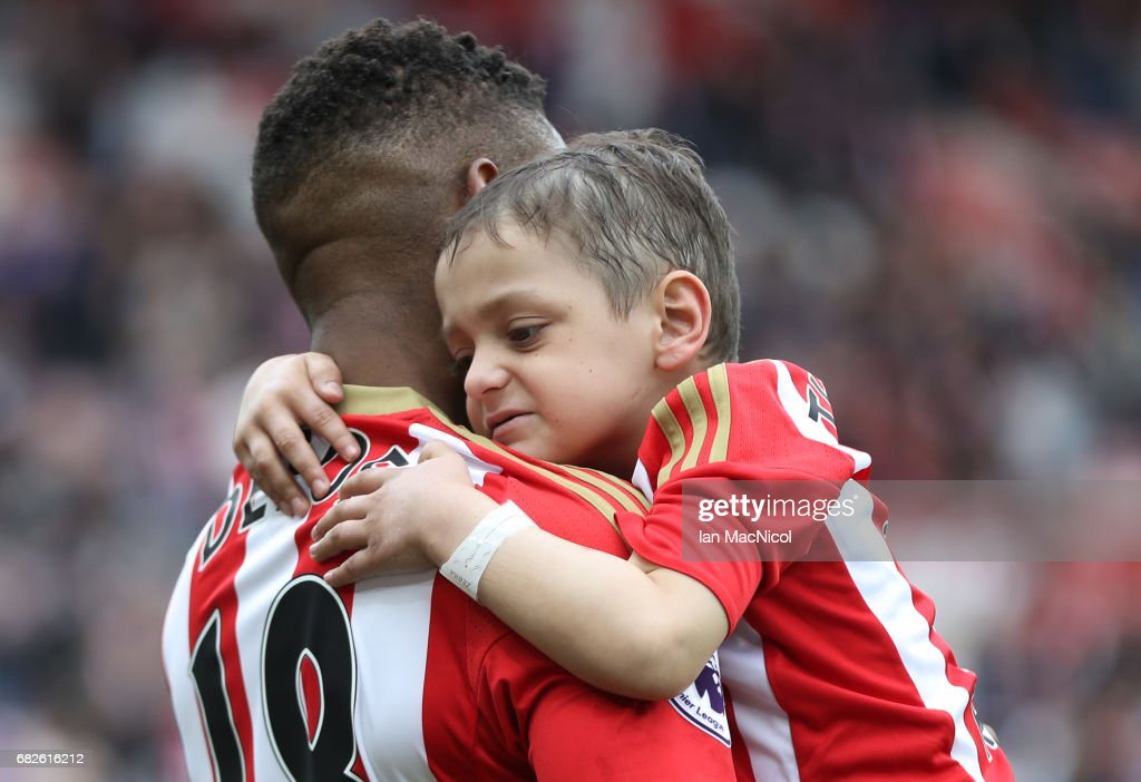 Jermain Defoe of Sunderland and Bradley Lowery are seen walking out prior to the Premier League match between Sunderland and Swansea City at Stadium of Light on May 13, 2017 in Sunderland, England.