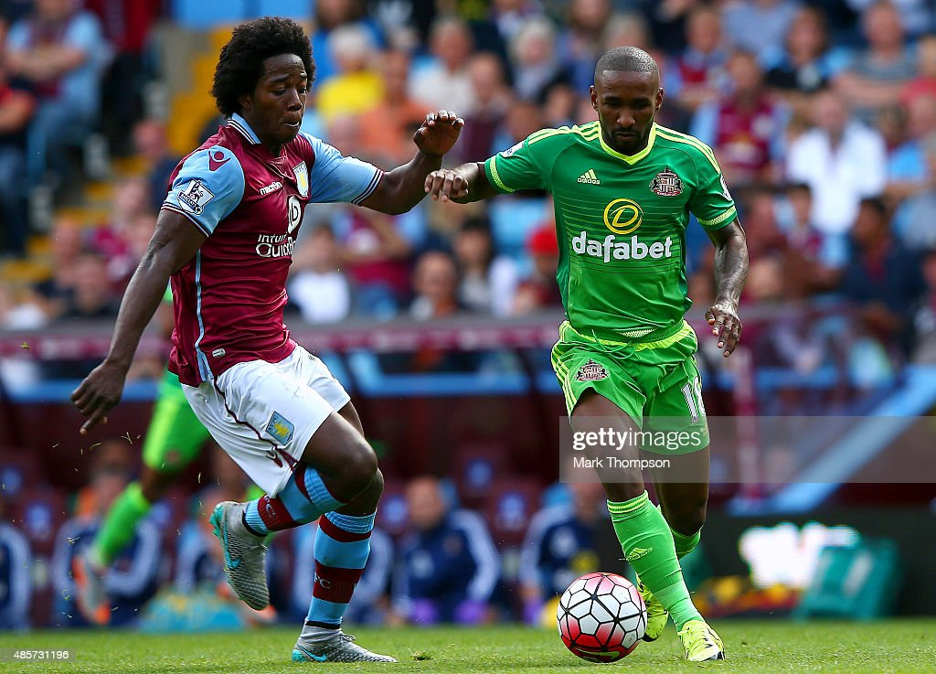 Jermain Defoe of Sunderland and Carlos Sanchez of Aston Villa compete for the ball during the Barclays Premier League match between Aston Villa and Sunderland at Villa Park on August 29, 2015 in Birmingham, England.