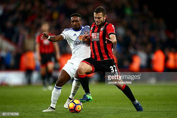 Jermain Defoe of Sunderland and Jack Wilshere of AFC Bournemouth battle for possession during the Premier League match between AFC Bournemouth and...