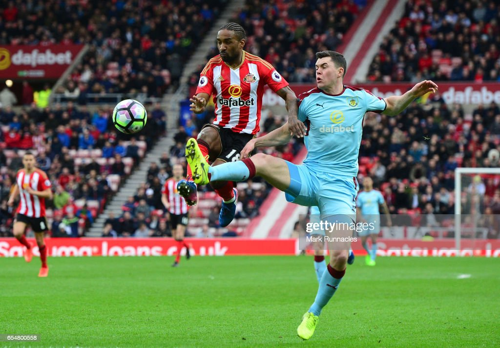 Jermain Defoe of Sunderland (L) and Michael Keane of Burnley (R) battle for possession during the Premier League match between Sunderland and Burnley at Stadium of Light on March 18, 2017 in Sunderland, England.