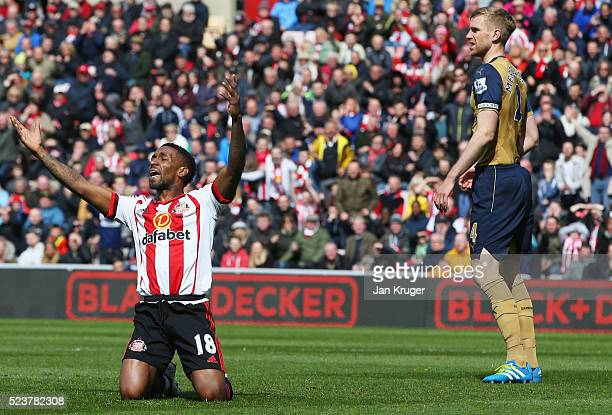 Jermain Defoe of Sunderland appeals for a penalty against Per Mertesacker of Arsenal during the Barclays Premier League match between Sunderland and...