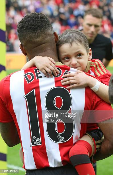 Jermain Defoe of Sunderland carries out mascot Bradley Lowery during the Premier League match between Sunderland and Swansea City at Stadium of Light...