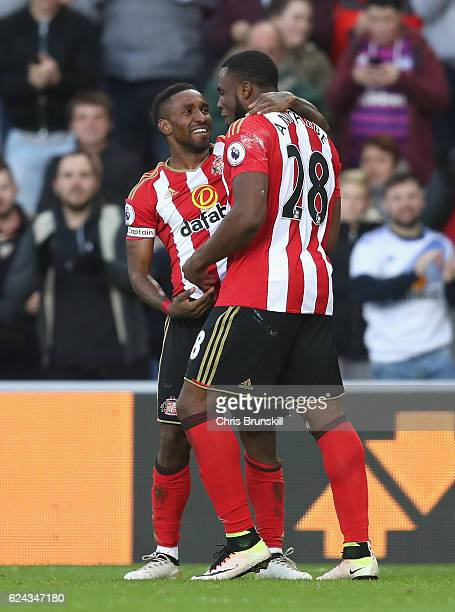 Jermain Defoe of Sunderland celebrates scoring his sides first goal and his 150th preimer leauge goal with Victor Anichebe of Sunderland during the...