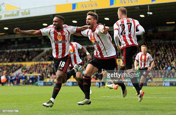 Jermain Defoe of Sunderland celebrates scoring his team's second goal with Fabio Borini during the Barclays Premier League match between Norwich City...