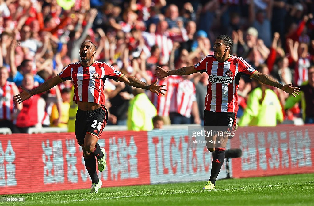 Jermain Defoe of Sunderland (L) celebrates scoring the opening goal with Patrick van Aanholt of Sunderland during the Barclays Premier League match between Sunderland and Newcastle United at Stadium of Light on April 5, 2015 in Sunderland, England.