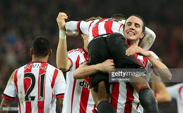 Jermain Defoe of Sunderland celebrates with John O'Shea after he scores the third Sunderland goal during the Barclays Premier League match between...