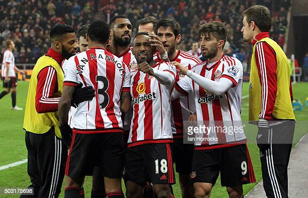 Jermain Defoe of Sunderland celebrates with teammates after he scores the second Sunderland goal during the Barclays Premier League match between...