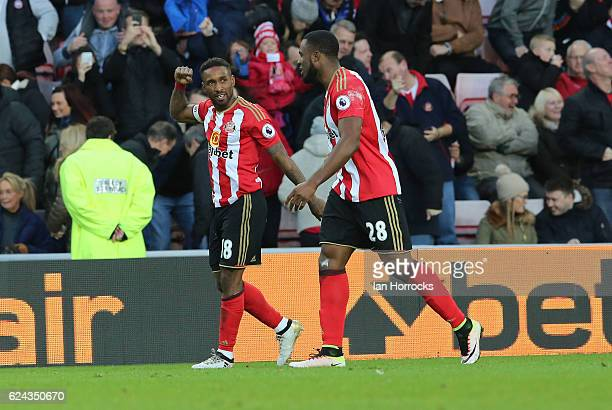 Jermain Defoe of Sunderland celebrates with Victor Anichebe after Defoe scored the opening goal during the Premier League match between Sunderland...