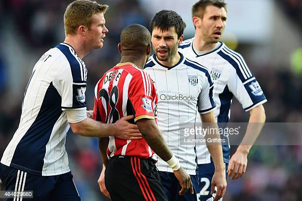 Jermain Defoe of Sunderland clashes with Claudio Yacob of West Brom during the Barclays Premier League match between Sunderland and West Bromwich...
