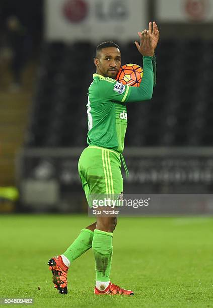 Jermain Defoe of Sunderland holding the match ball to celebrate his hat trick and 4-2 win after the Barclays Premier League match between Swansea...