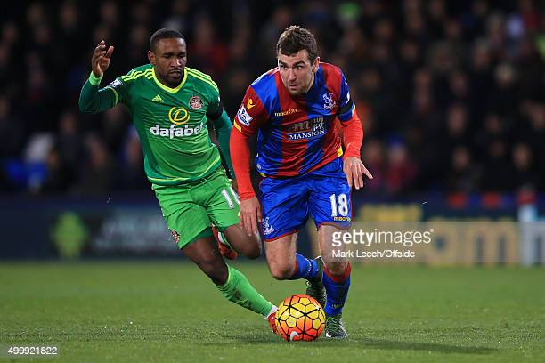 Jermain Defoe of Sunderland in action with James McArthur of Crystal Palace during the Barclays Premier League match between Crystal Palace and...