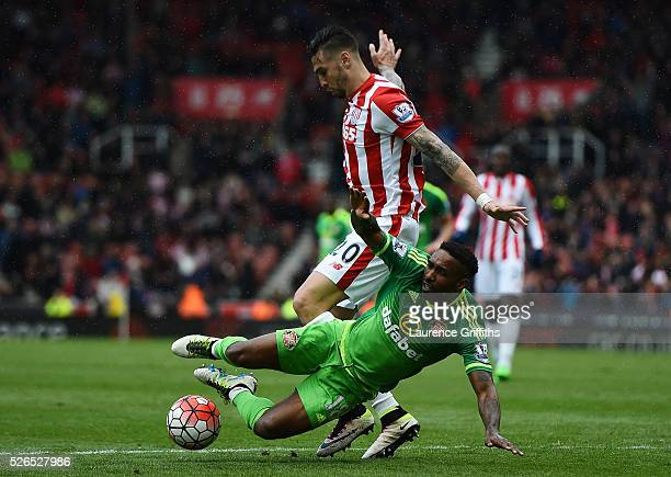 Jermain Defoe of Sunderland is fouled by Geoff Cameron of Stoke City in the area resulting in the penalty kick during the Barclays Premier League...