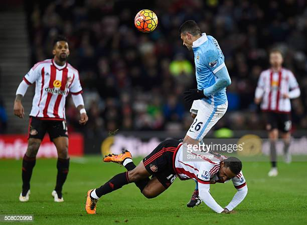 Jermain Defoe of Sunderland is fouled by Martin Demichelis of Manchester City during the Barclays Premier League match between Sunderland and...