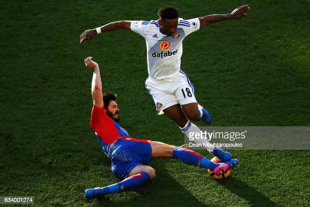 Jermain Defoe of Sunderland is tackled by James Tomkins of Crystal Palace during the Premier League match between Crystal Palace and Sunderland at...