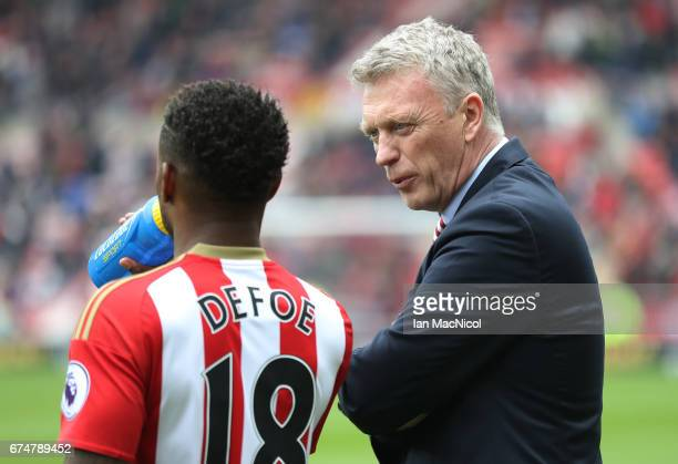 Jermain Defoe of Sunderland speaks with David Moyes Manager of Sunderland during the Premier League match between Sunderland and AFC Bournemouth at...
