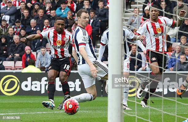 Jermain Defoe of Sunderland watches his shot go just wide during the Barclays Premier League match between Sunderland and West Bromwich Albion at the...