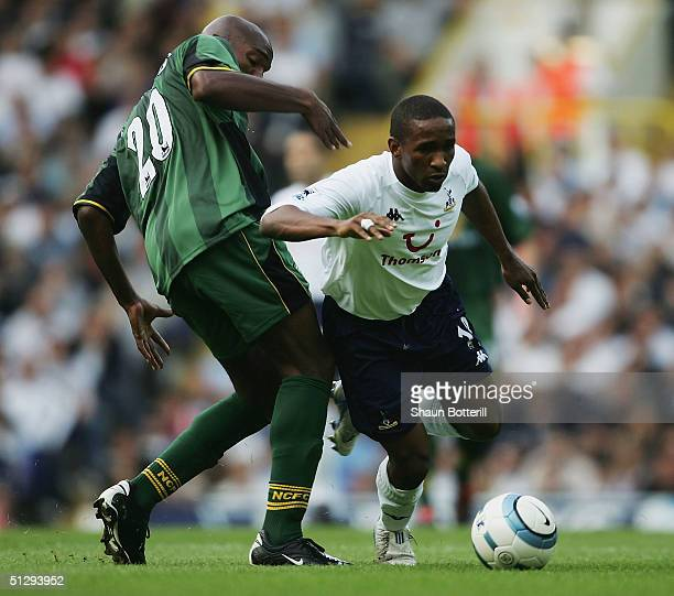 Jermain Defoe of Tottenham breaks past Damien Francis of Norwich during the Barclays Premiership match between Tottenham Hotspur and Norwich City at...