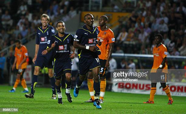 Jermain Defoe of Tottenham Hotspur celebrates his goal with Aaron Lennon during the Barclays Premier League match between Hull City and Tottenham...