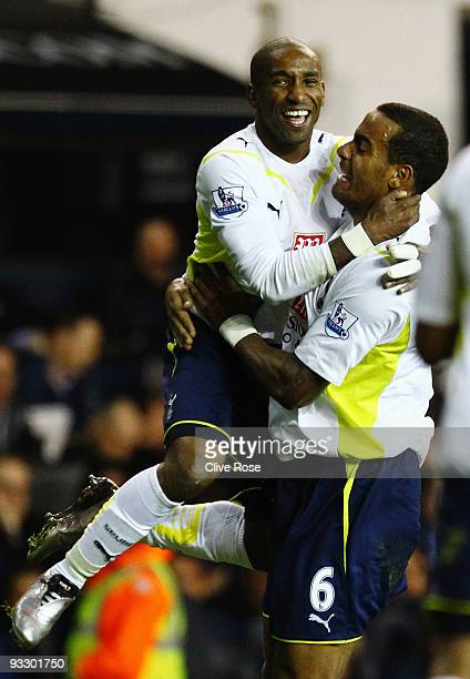 Jermain Defoe of Tottenham Hotspur celebrates his hatrick goal with Tom Huddlestone during the Barclays Premier League match between Tottenham...
