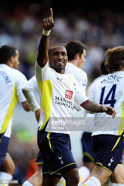 Jermain Defoe of Tottenham Hotspur celebrates scoring their first goal from the penalty spot during the Barclays Premier League match between...