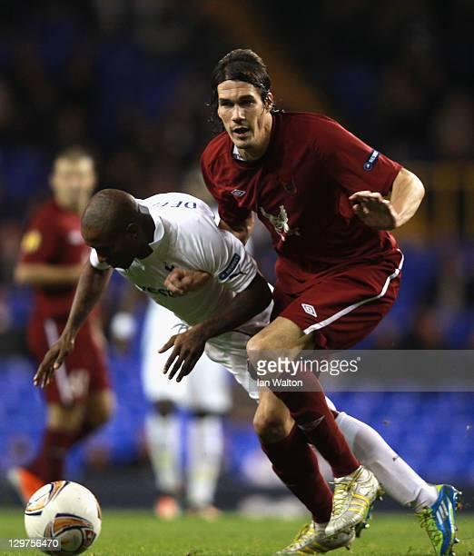 Jermain Defoe of Tottenham Hotspur falls under the challenge by Cesar Navas of FC Rubin Kazan during the UEFA Europa League Group A match between...