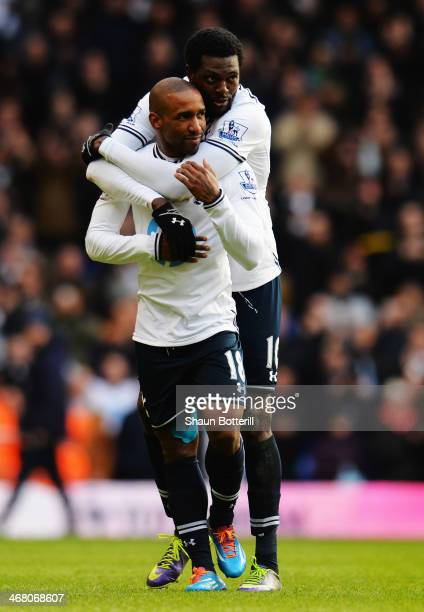 Jermain Defoe of Tottenham Hotspur is embraced by his team mate Emmanuel Adebayor at the end of his final home game following the Barclays Premier...