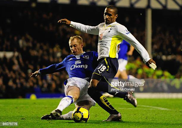 Jermain Defoe of Tottenham Hotspur is tackled by Tony Hibbert of Everton during the Barclays Premier League match between Everton and Tottenham...