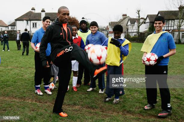 Jermain Defoe of Tottenham Hotspur pays a surprise visit to a local school in Wembley to deliver the new adidas Official Match Ball for the 2011 UEFA...