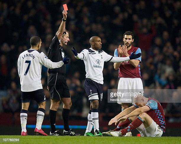 Jermain Defoe of Tottenham Hotspur reacts as he is sent off by referee Martin Atkinson during the Barclays Premier League match between Aston Villa...